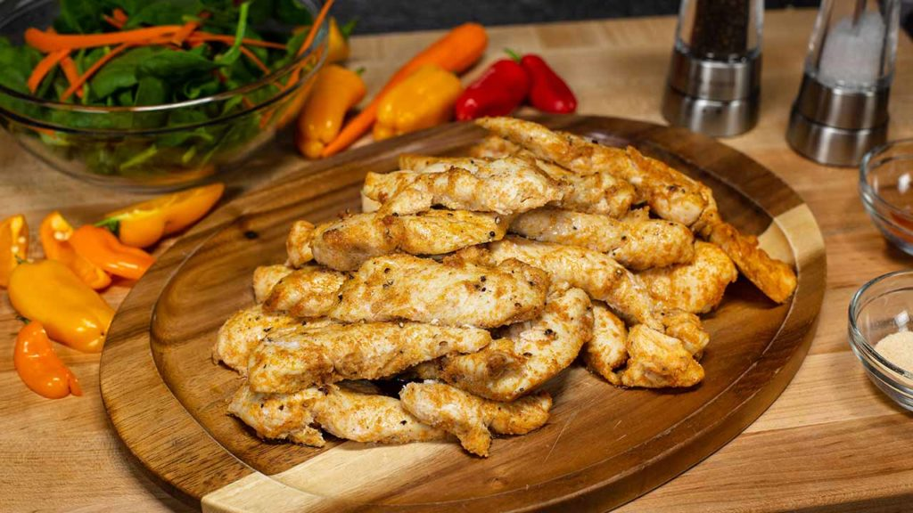 chicken tenders on a cutting board