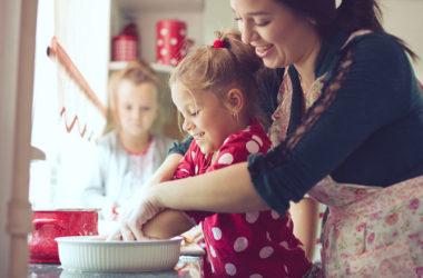 mom teaching kids to cook