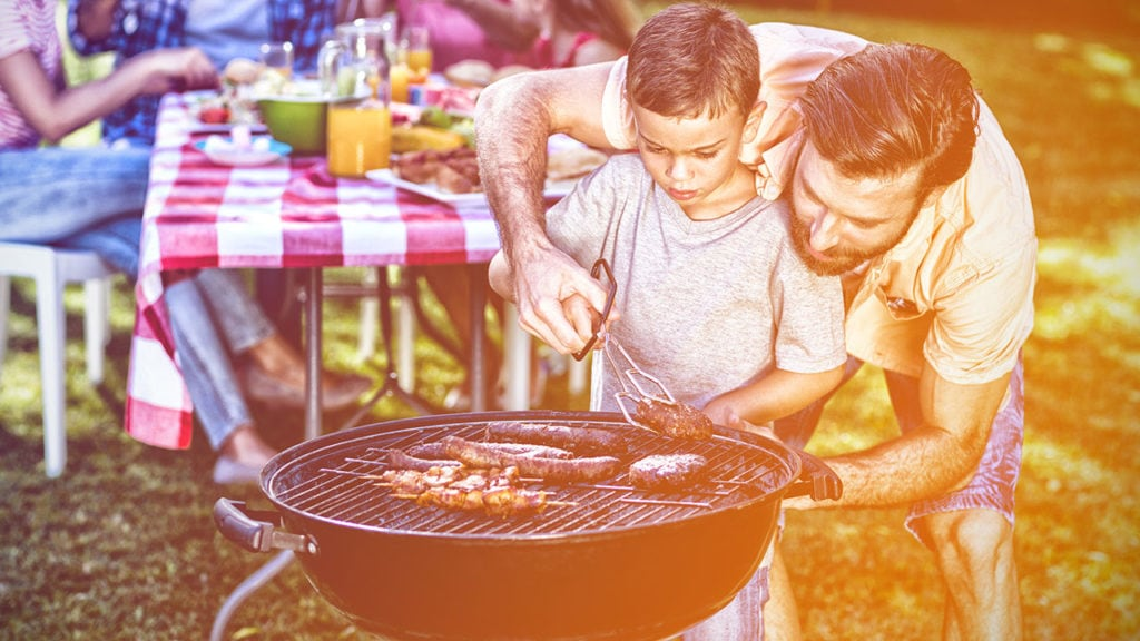 dad and son grilling