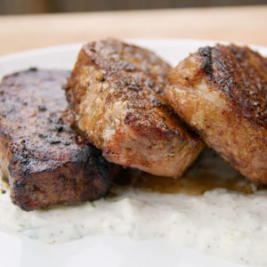 three grilled pork chops